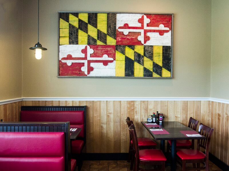 Adam's Grille & Taphouse interior wooden Maryland flag