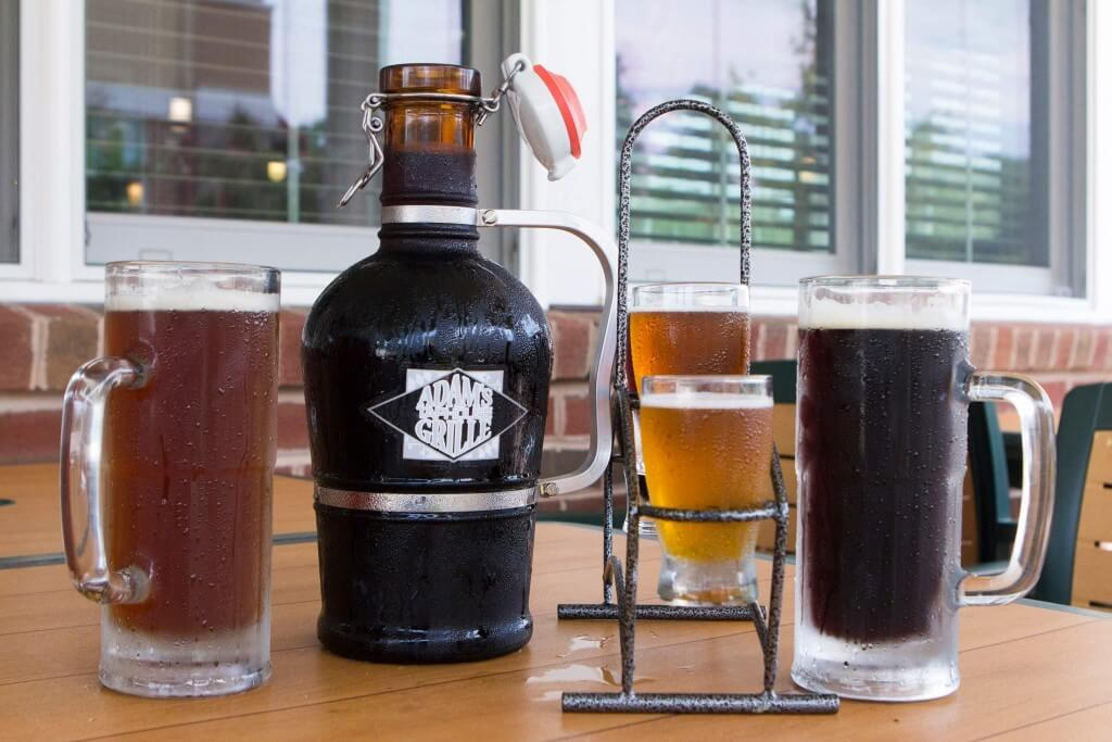 Adams Grille & Taphouse growler of beer, pints and a flight of beer